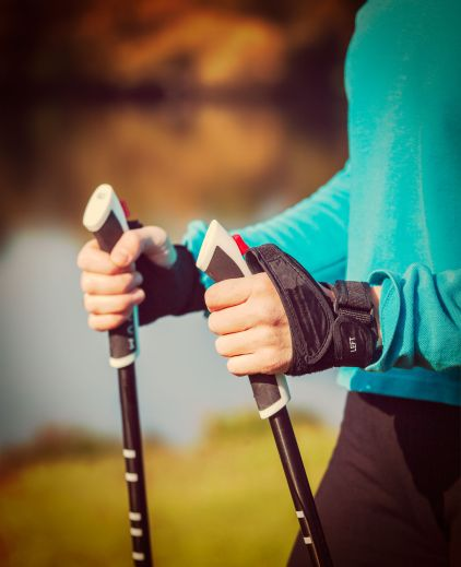 34457279 - woman's hand holding nordic walking poles